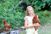 Young Blonde Girl in the Garden with Her Chickens — Stok fotoğraf