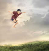 Happy Young Boy Jumping — Stock Photo