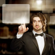 Stock Photo: MLooking and Pointing Touch Screen
