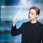 Man pressing modern touch screen button — Stock Photo