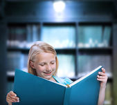Little Girl Reading a Big Book — Stock Photo