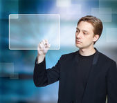 Man pressing modern touch screen button — Stock Photo
