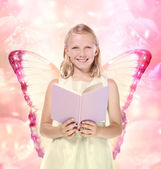 Little Blonde Girl Reading a Book - Fantasy — Stock Photo