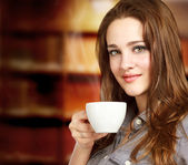 Beautiful Young Women Drinking a Cup of Coffee — Stock Photo