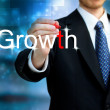 Stock Photo: Young business mwriting word Growth