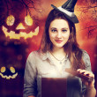 Halloween Cute Witch with Halloween Pumpkins — Стоковая фотография