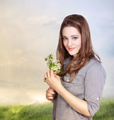 Young Woman Holding Flowers — Stock Photo