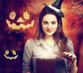 Halloween Cute Witch with Halloween Pumpkins — Foto de Stock