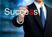 Jonge zakenman schrijven van het woord succes — Stockfoto
