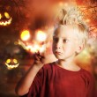 Stock Photo: Boy Touching Halloween Ghost