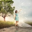 Stock Photo: Little Girl at a Shining Brook