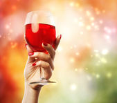 Woman holding a wine glass — Stock Photo