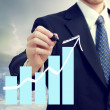 Business Man with Chart Showing Growth — Foto de Stock