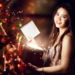 Stock Photo: Girl Opening a Gift Box