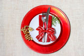 Holiday plates with silverware — Stock Photo