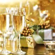Foto Stock: Two champagne glasses on dinner table