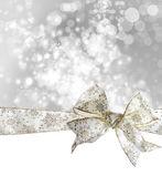 Beyaz kar tanesi yay ve şerit — Stok fotoğraf