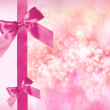Pink Bow and Ribbon with Abstract Lights — Stock Photo