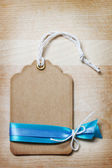 Handmade Price Tag with Blue Ribbons — Stock Photo