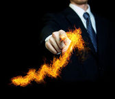 Businessman Touching a Fire Arrow — Stock Photo