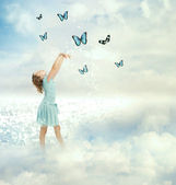 Little Girl with Butterflies — Stock Photo