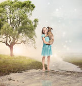 Girl Holding her Puppy at a Magical Brook — Stock Photo