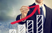 Businessman with Graph Representing Growth — Stockfoto