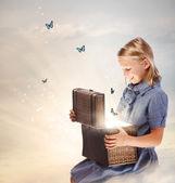 Blond Girl Opening a Treasure Box — Stock Photo