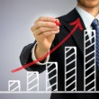 Stockfoto: Businessman drawing a rising arrow