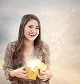 Girl Opening a Shinning Giftbox — Stock Photo