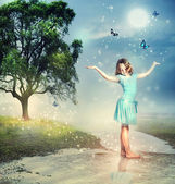 Girl with Blue Butterflies at a Magical Brook — Stockfoto