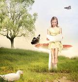 Meisje het lezen van een boek op paddestoel — Stockfoto
