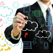 Businessman with cloud computing themed pictures — Stockfoto