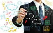 Businessman with cloud computing themed pictures — Zdjęcie stockowe