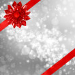 Red Bow and Ribbon with Abstract Lights — Stock Photo