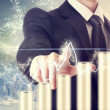 Businessman with Graph Representing Growth — Stock Photo