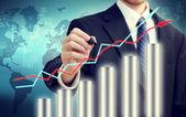 Biznesmen z wykresu — Zdjęcie stockowe