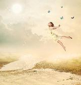 Little Girl Flying at Twilight — Stock Photo