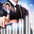 Businessman with Graph and Light Bulb — Stock Photo