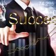 Foto de Stock  : BusinessmPointing to Success with Rising Graph and Light Bulb
