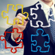 Businessman with puzzle pieces — Stock Photo