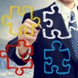Stock Photo: Businessmwith puzzle pieces