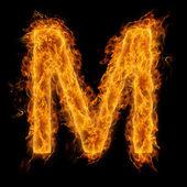Hořící písmeno m — Stock fotografie