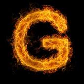 Hořící písmeno g — Stock fotografie
