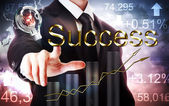 Businessman Pointing to Success with Rising Graph and Light Bulb — Stock Photo
