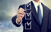 Business man with checkboxes — Stok fotoğraf
