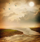 Butterflies and moon in fantasy landscape — Stock Photo