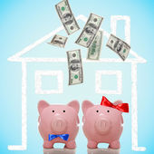 Piggy bank couple buying their dream home — ストック写真