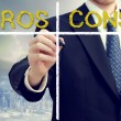 Business man writing pros and cons — Stock fotografie