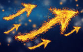 Flaming rising arrows — Stock Photo